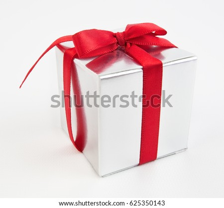 Silver gift box with red ribbon bow.