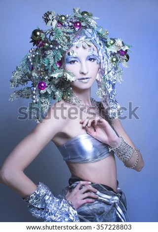Silver girl. Young woman in creative New Year image.