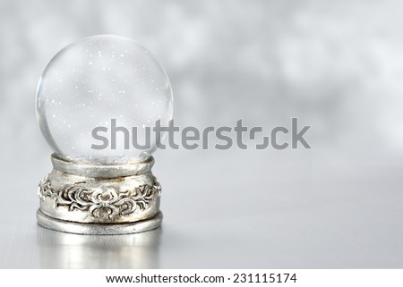 silver glass ball and snow space  - stock photo