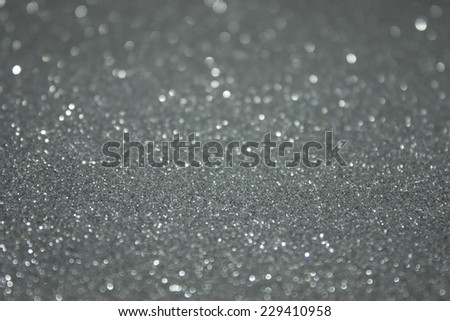 Silver Glitter background texture with blurred shallow depth of field. Perfect for Luxury, fashion or Christmas and holiday season designs. - stock photo