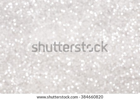 Silver glitter bokeh background. Blurred glowing circles. - stock photo