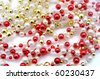Silver,gold  and red beads isolated on white - stock photo