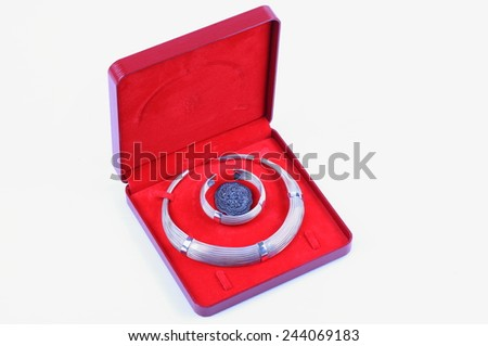 Silver gold jewelery in red gift box on white background