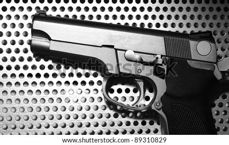 silver gun  on metal background - stock photo