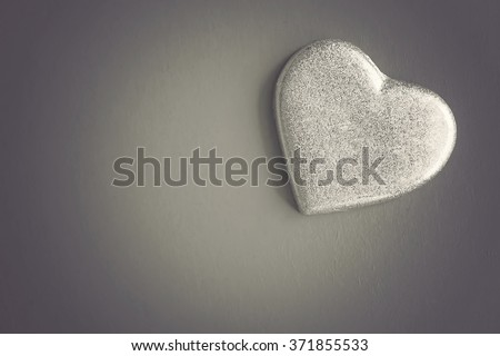 Silver heart on black background. Concept of Relationship. Vintage effect.
