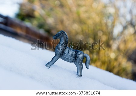Silver horses in the snow, meant for decoration during holidays