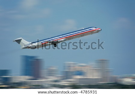 Silver jetliner departing with motion blur