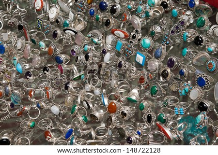 silver jewelry on a glass showcase - stock photo