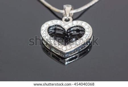 Silver jewelry pendant with diamond on dark background / silver jewelry / necklaces with heart pendants on black background / necklaces with heart pendants for woman