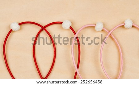 Silver jewels with colorful precious stones and wooden background