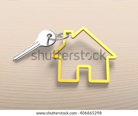 Silver key and house shape key ring, on wooden background.