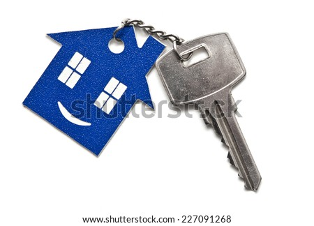 silver keys with house figure on the white background  - stock photo