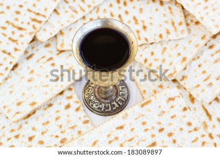 Silver kiddush wine cup  for passover with matzot, selective focus