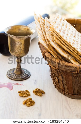 Silver kiddush wine cup  for passover with matzot, selective focus - stock photo