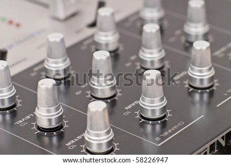 Silver Knobs on Audio Mixing Console - stock photo