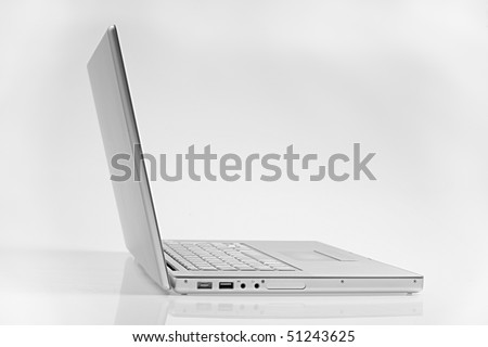 silver laptop isolated on white background with clipping path. side view. clipping path saved - stock photo