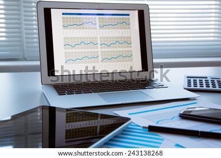 Silver laptop on the table. Workplace. - stock photo