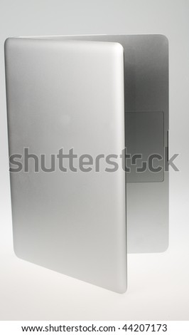 Silver laptop standing up - stock photo