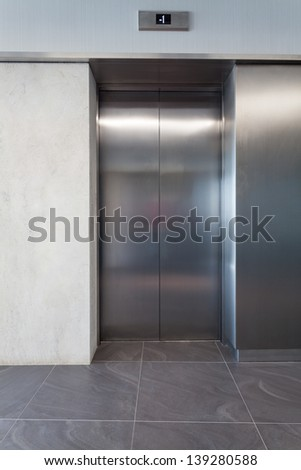 Silver lift door in a business centre - stock photo