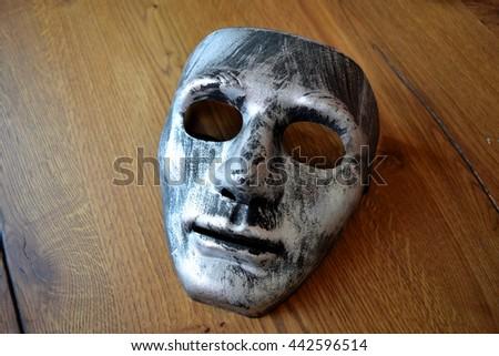 silver mask - stock photo