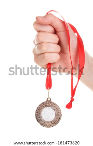Silver medal in hand isolated on white - stock photo