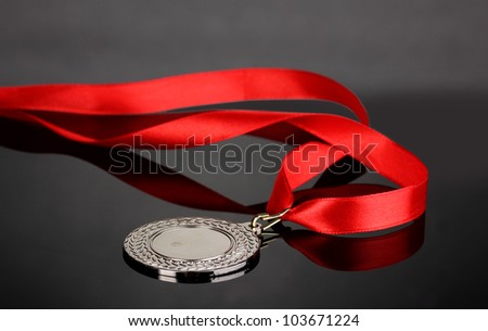 Silver medal on grey background - stock photo