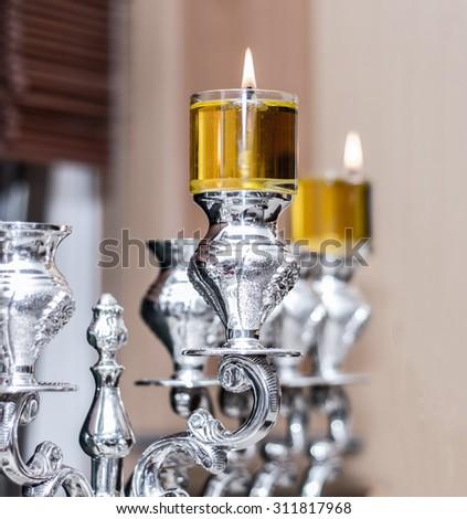silver Menorah Hanukkah With olive oil - stock photo
