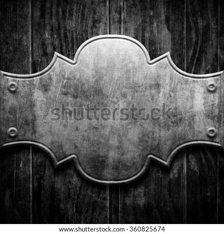 Silver metal luxury plaque on black wood background - stock photo