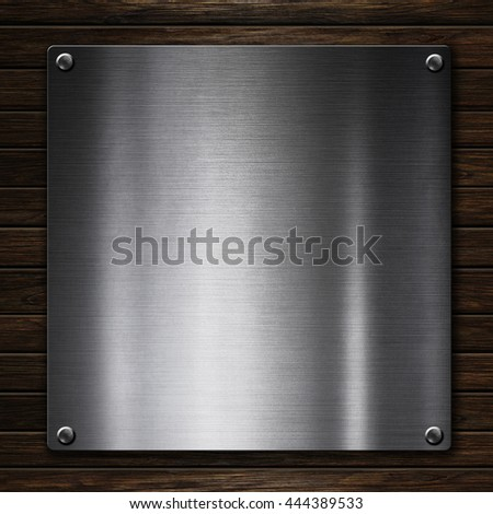 Silver metal plaque on wood background