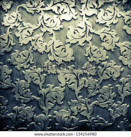 Silver metal plate with classic ornament - stock photo