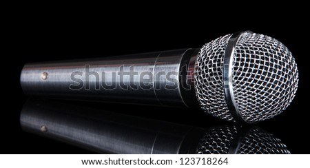 Silver microphone isolated on black