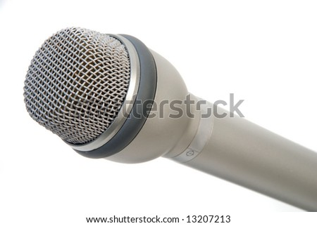 Silver microphone over white