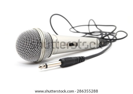 Silver microphone with a cord on white background