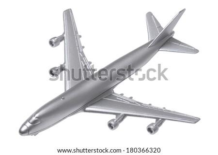 Silver model airplane on white - stock photo