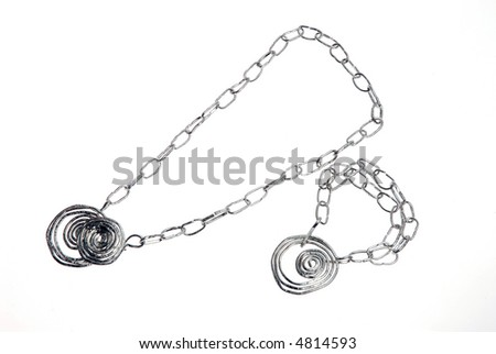 silver necklace and bracelet isolated on white