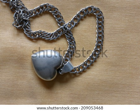 Silver necklace with heart                         - stock photo