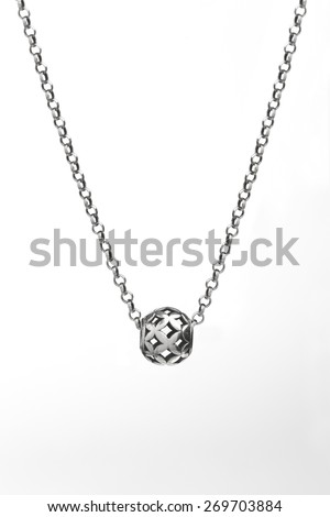 silver necklace with small ball - stock photo