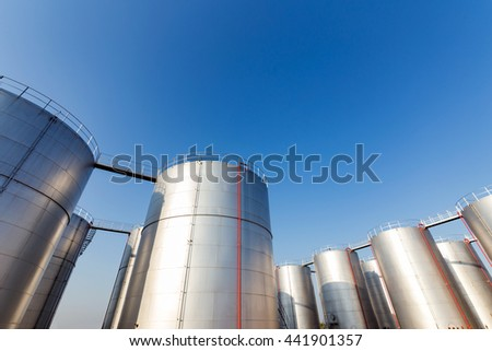 Silver oil tank in the blue sky background