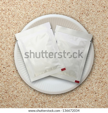 silver package on white plate - stock photo