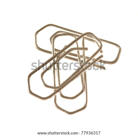 silver paper clips isolated on a white background