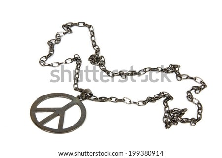 silver peace pendant on chain from 1960's - stock photo