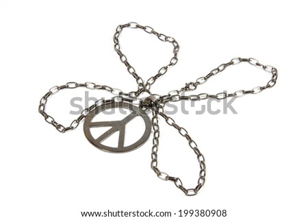 silver peace pendant with chain shaped as four leaf clover - stock photo