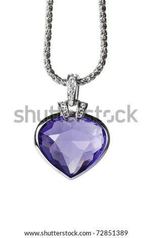 Silver pendant and blue heart shaped gemstone on white background - stock photo