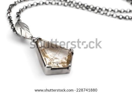 Silver pendant with quartz gem stone - stock photo