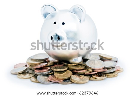 Silver piggy bank or money box on pile of silver Euro coins, isolated on white background. - stock photo