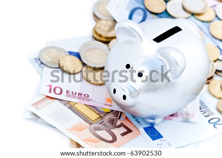 Silver piggy bank surrounded by Euro notes and coins on white background