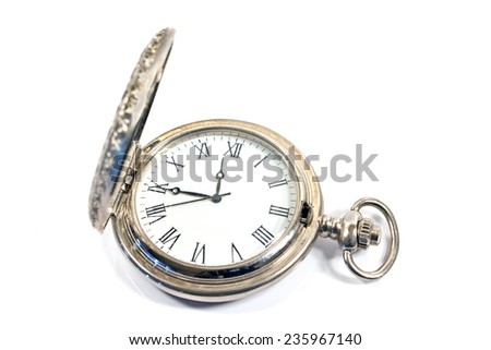 Silver pocket watch isolated on white - stock photo