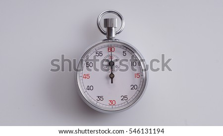 Silver pocket watch on white background - time concept