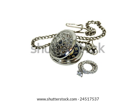 Silver pocket watch with a metal chain and diamond engagement ring with facets that sparkle brightly in the light symbolizing eternity of love