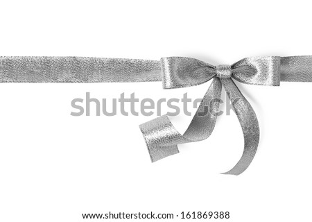 Silver ribbon with bow on white - stock photo